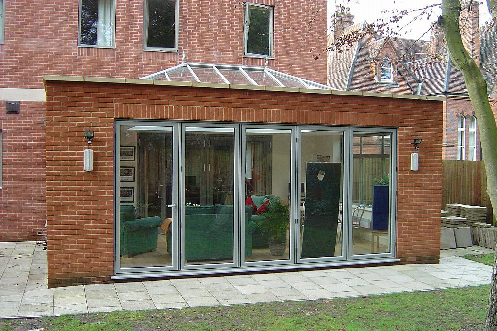 Brick Built Extension With Glass Roof And 5 Door Bi