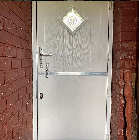 Sliders - Stable Doors in White with Bullseye Glass